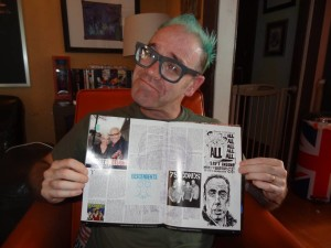 DESCENDENTS/ALL artist, CHRIS SHARY, holding his New Noise Magazine interview done by Damian. Now being used on a Podcast interview by Damian. Inception light.